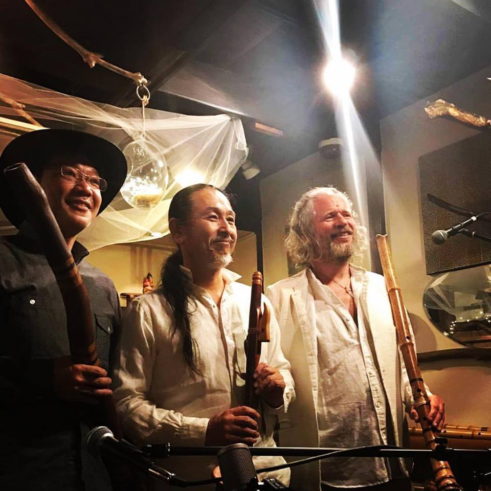 Adrian Freedman and shakuhachi on stage with Hiroki Okano and Kenji Mikami