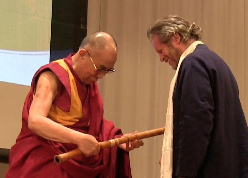 The Dalai Lama holding the shakuhachi with Adrian Freedman Press
