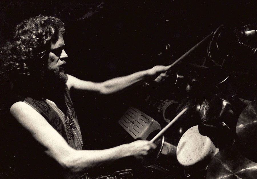 Profile shot of Adrian Freedman playing drums in Odin Features