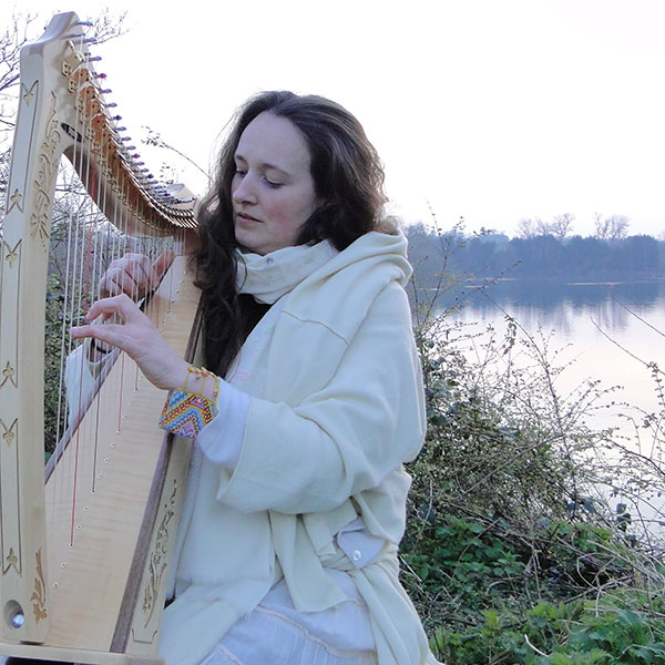 Camille Marie playing harp