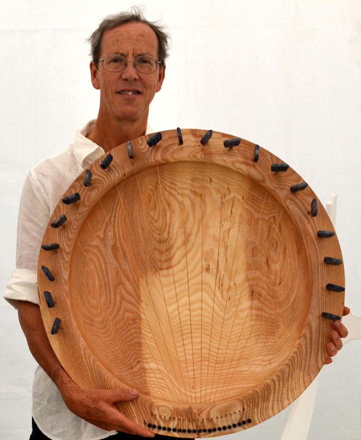 Tobias Kaye holding a Sounding Bowl. Image from souundingbowls.com Projects