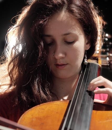 Girl pierced nose play Cello