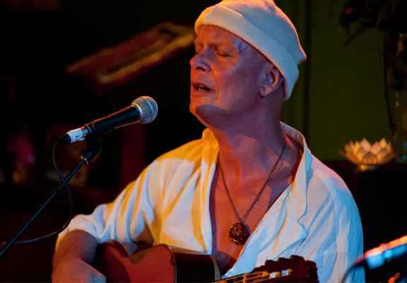 Musician with white shirt and hat Darpan