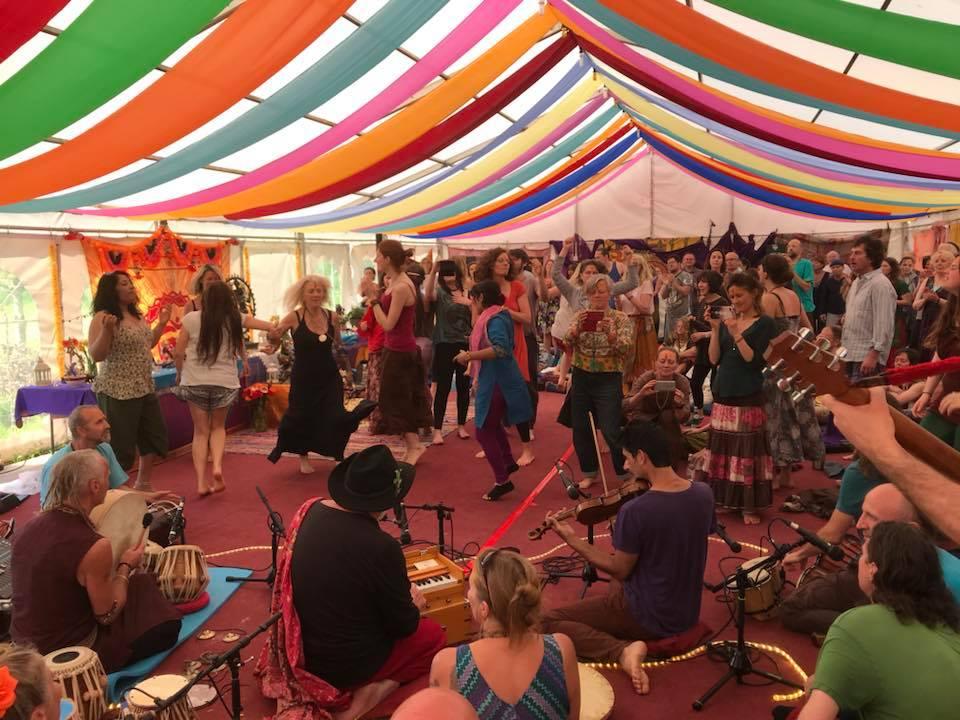 People dancing celebrating playing music