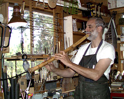 Man playing bamboo flute at workshop