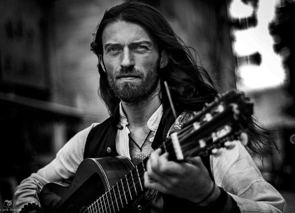 Estas Tonne playing guitar