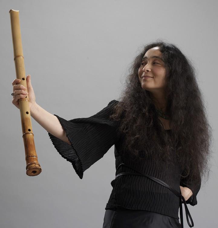 Woman with bamboo flute Kiku